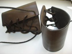 PAIR OF BROWN  LEATHER BRACERS