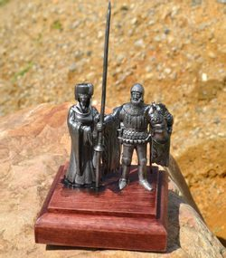 PAIR OF BURGUNDY, historical tin statue