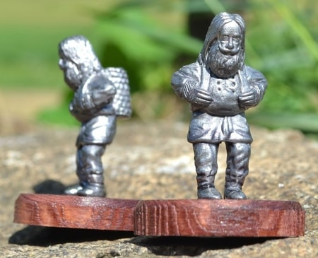 DWARF WITH A BASKET, historical tin statue