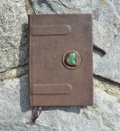 Bookbinding in leather, with semi-precious stone
