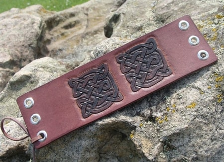 CARRAROE, laced leather cuff, hand carved