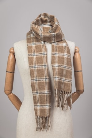 Product Features warm, and fashionable. Stay trendy and cozy in this knit camel scarf.