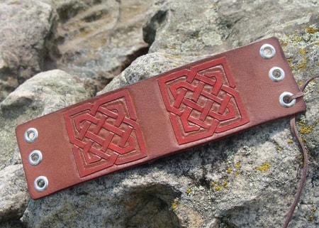 TULACH, laced leather cuff, hand carved