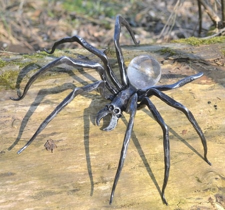 Forged spider figure with glass Sculpture