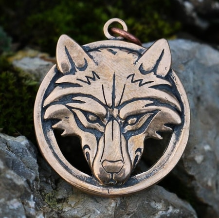 Wolf's head in a ring, bronze pendant